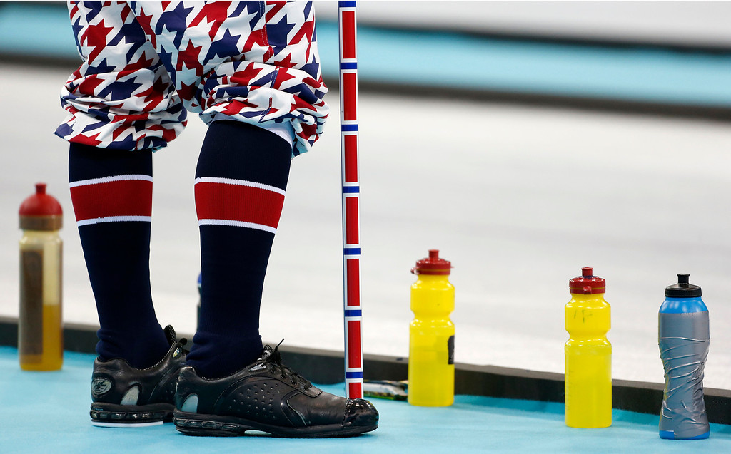 . A Norwegian curler stands next to water bottles during men\'s curling competition against Germany at the 2014 Winter Olympics, Wednesday, Feb. 12, 2014, in Sochi, Russia. (AP Photo/Robert F. Bukaty)