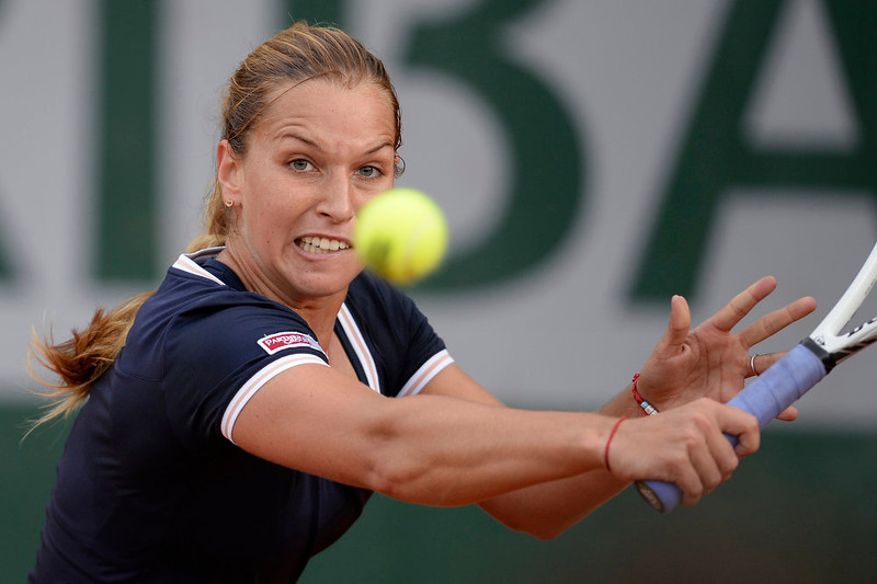 . Slovakia\'s Dominika Cibulkova hits a backhand shot to Ukraine\'s Lesia Tsurenko during a French tennis Open first round match at the Roland Garros stadium in Paris on May 28, 2013.  MARTIN BUREAU/AFP/Getty Images