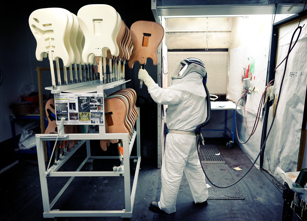 """. Freshly-painted Fender Stratocaster electric guitar bodies are stacked at the factory in Corona, Calif. on Monday, Oct. 14, 2013. Described as \""""space aged\"""" and \""""futuristic\"""" when it debuted in 1954, the Stratocaster\'s appearance was unlike any other guitar available at the time. (AP Photo/Matt York)"""