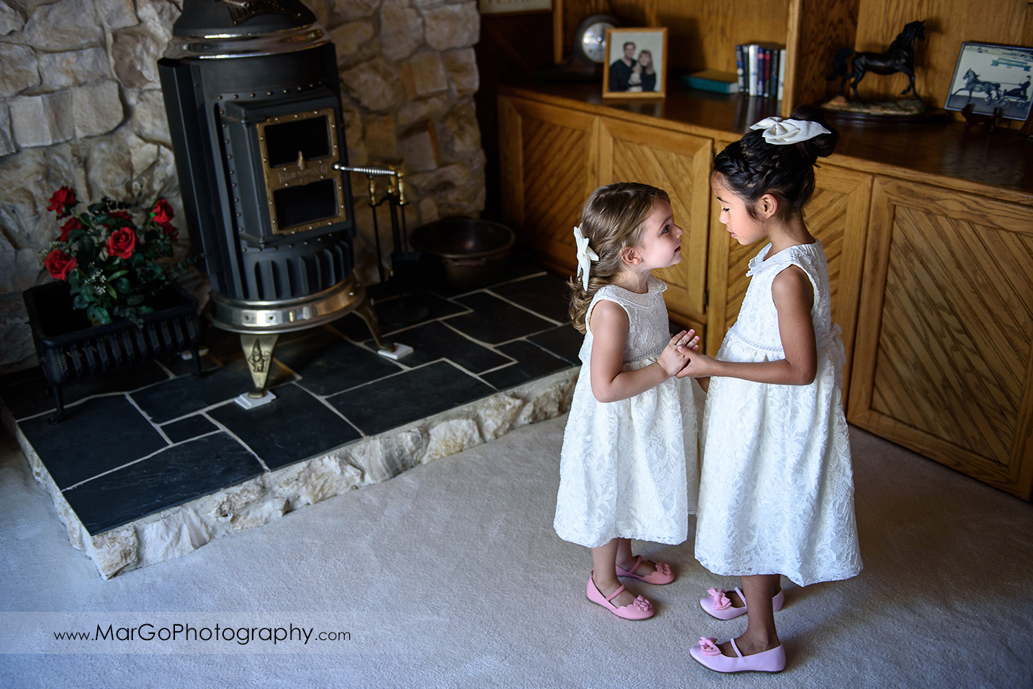 flower girls holding hands and looking at each other