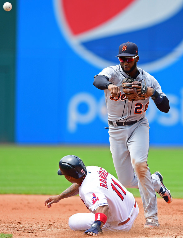 . Detroit Tigers\' Niko Goodrum gets Cleveland Indians\' Jose Ramirez out at second base in the fourth inning of a baseball game, Sunday, June 24, 2018, in Cleveland. Edwin Encarnacion would be out at first for the double play. (AP Photo/David Dermer)