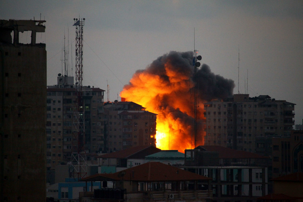 . A ball of fire rises from a building following an Israeli air strike in Gaza City on August 23, 2014. Egypt is to invite Israeli and Palestinian delegations to return to Cairo to resume talks on a long-term truce for Gaza, Palestinian president Mahmud Abbas announced. MOHAMMED OTHMAN/AFP/Getty Images