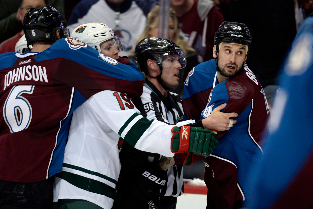 . Erik Johnson (6) of the Colorado Avalanche holds onto Stephane Veilleux (19) of the Minnesota Wild as he gets into it with Patrick Bordeleau (58) of the Colorado Avalanche during the second period of action. linesman David Brisebois (96) breaks it up.  The Colorado Avalanche hosted the Minnesota Wild for the first playoff game at the Pepsi Center on Thursday, April 17, 2014. (Photo by John Leyba/The Denver Post)
