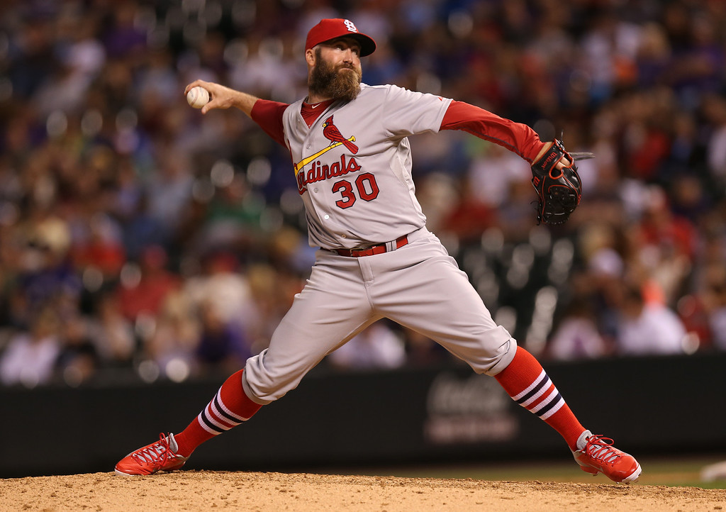 . St. Louis Cardinals relief pitcher Jason Motte works against the Colorado Rockies to get the final out in the ninth inning of the Cardinals\' 8-0 victory in a baseball game in Denver on Monday, June 23, 2014. (AP Photo/David Zalubowski)