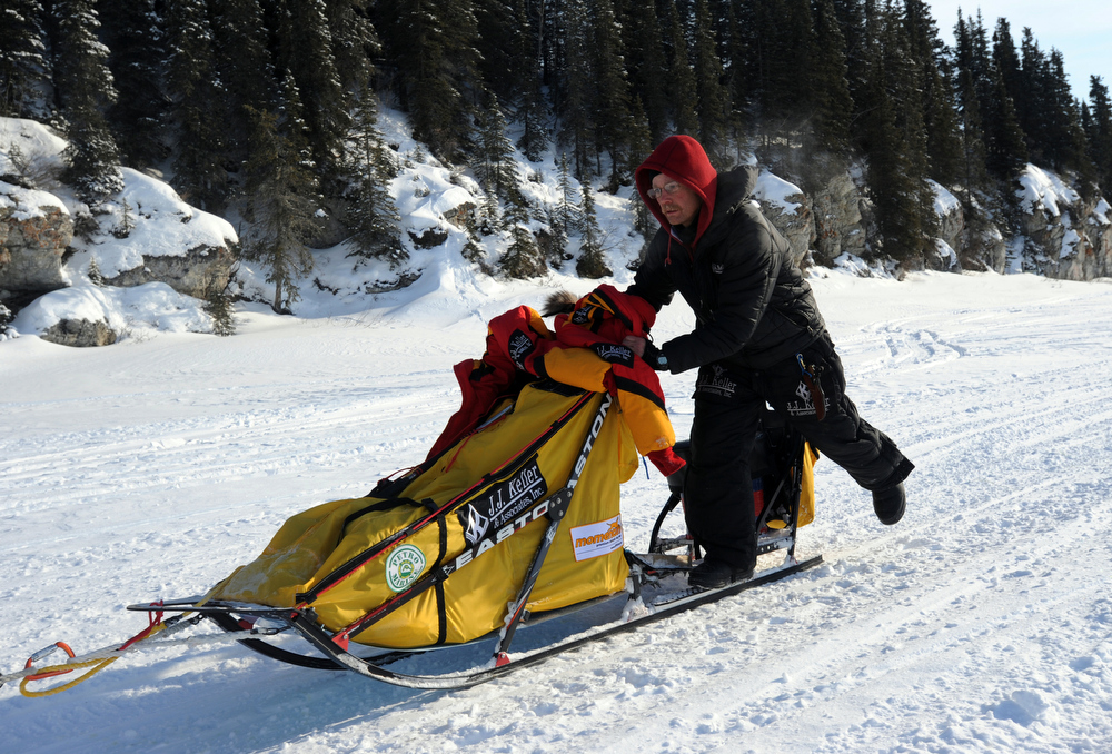 . Mitch Seavey leaves White Mountain in Alaska, Tuesday, March 12, 2013, during the Iditarod Trail Sled Dog Race. (AP Photo/The Anchorage Daily News, Bill Roth)