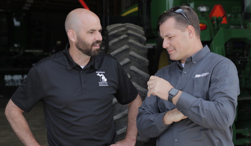 MFB Manager of Governmental Affairs, Matt Smego, listens to MDARD Deputy Director Ken McFarlane at Smuts Farms in Eaton County.