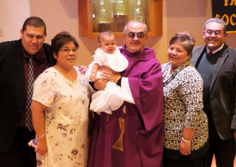 IMG_1626 family with priest.jpg