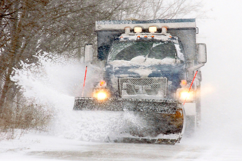 . A Marion snow plow works to clear a section of Montpelier Pike near Bethlehem Road in Grant County, Ind., on Wednesday, Dec. 26, 2012. (AP Photo/Chronicle-Tribune, Jeff Morehead)
