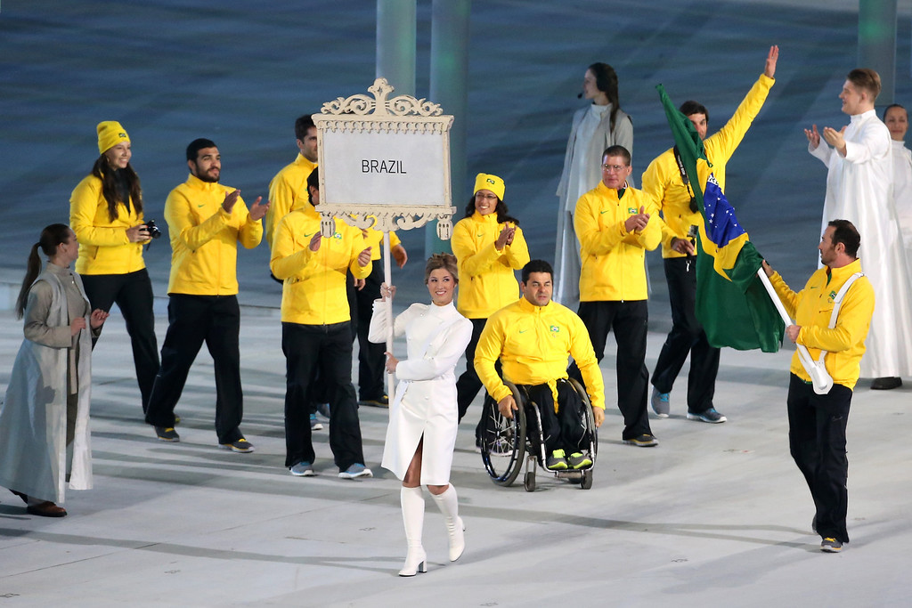 . Brazil enter the arena lead by flag bearer Andre Pereira during the Opening Ceremony of the Sochi 2014 Paralympic Winter Games at Fisht Olympic Stadium on March 7, 2014 in Sochi, Russia.  (Photo by Ian Walton/Getty Images)
