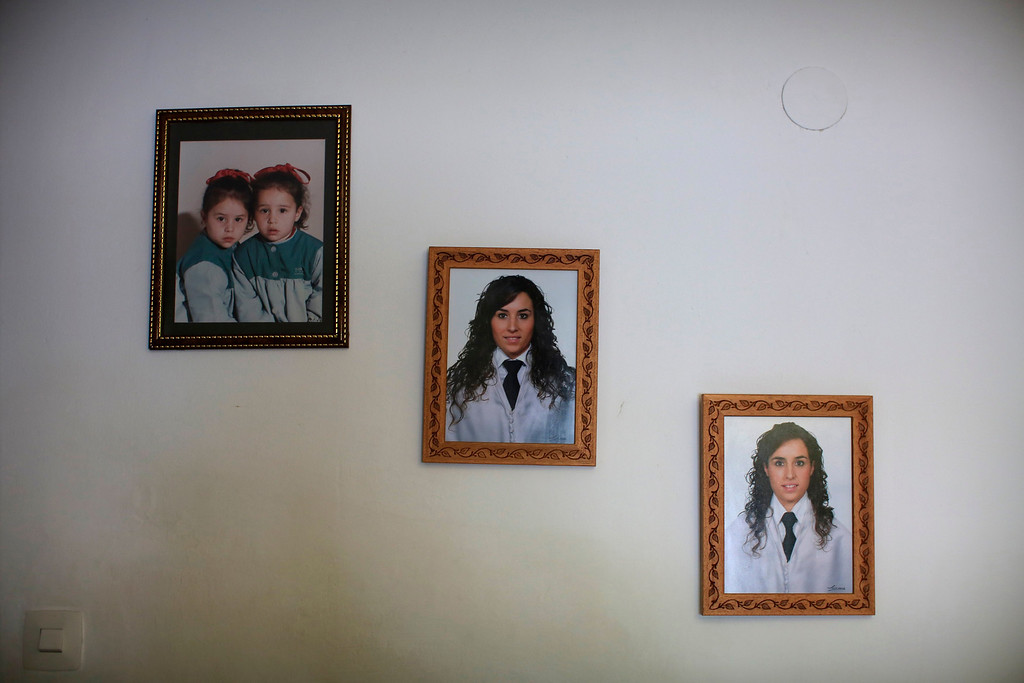 . Photographs of Spanish nurses Maria Jose Marin (R) and her twin sister Maria Teresa (C), taken at their graduation, and as children at the age of two (L), hang on the wall of the living room in their home in Paradas, southern Spain June 1, 2013. After months of studying Dutch, a group of young Spanish nurses moved to the Netherlands to take up work, fleeing a dismal job market at home. Spain\'s population dropped last year for the first time on record as young professionals and immigrants who moved here during a construction boom head for greener pastures. Spain\'s jobless rate is 27 percent, and more than half of young workers are unemployed. For Spanish nurses, the Netherlands\' nursing deficit is a boon. Picture taken June 1, 2013. REUTERS/Marcelo del Pozo