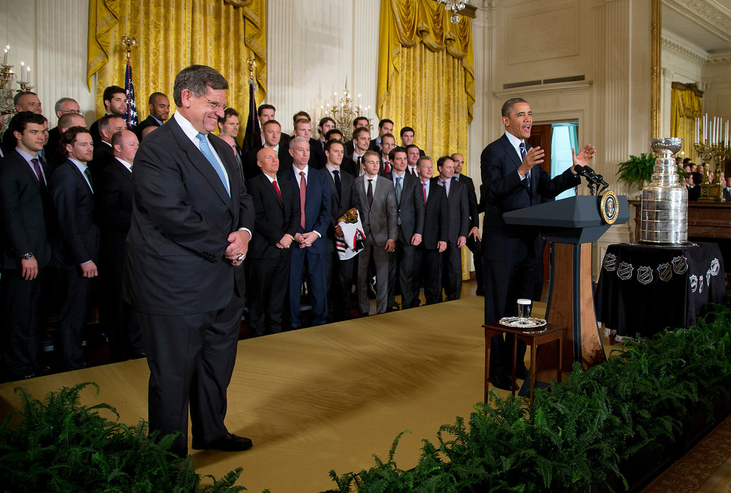 ". President Barack Obama in the East Room of the White House in Washington, Monday, Nov. 4, 2013, during a ceremony where he honored the NHL 2013 Stanley Cup hockey champion Chicago Blackhawks. Team Chairman ""Rocky\"" Wirtz is at left.  (AP Photo/ Evan Vucci)"