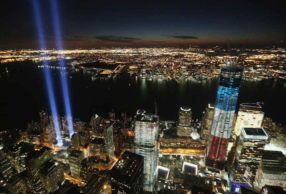 . The �Tribute in Light� shines as One World Trade Center (R) rises under construction on the eleventh anniversary of the terrorist attacks on lower Manhattan at the World Trade Center on September 11, 2012 in New York City. New York City and the nation are commemorating the eleventh anniversary of the September 11, 2001 attacks which resulted in the deaths of nearly 3,000 people after two hijacked planes crashed into the World Trade Center, one into the Pentagon in Arlington, Virginia and one crash landed in Shanksville, Pennsylvania.  (Photo by Mario Tama/Getty Images)