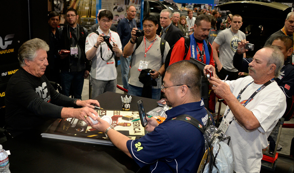 . Nov 6,2013 Las Vegas NV. USA. Racing legend  Mario Andretti signs autographs at the Magnaflow booth during the second day of the 2013 SEMA auto show. Photo by Gene Blevins/LA Daily News