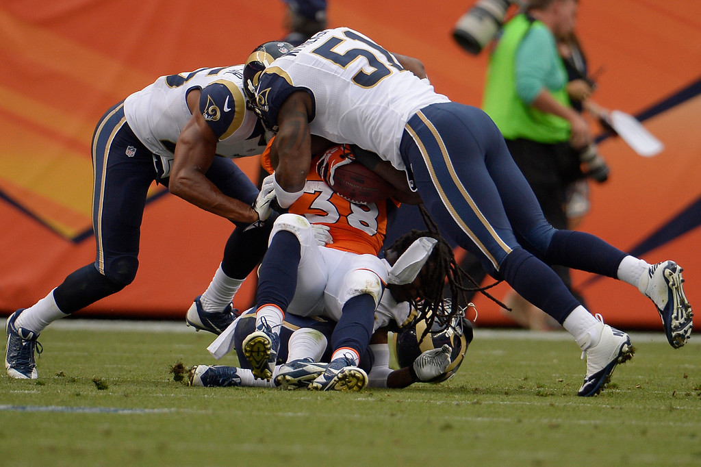 . DENVER, CO. - August 24: Running back Montee Ball (38) of the Denver Broncos gets gang tackled by the St. Louis Rams defense. The Denver Broncos vs the St. Louis Rams during the 3rd pre-season game of the season at Sports Authority Field at Mile High. August 24, 2013 Denver, Colorado. (Photo By Joe Amon/The Denver Post)