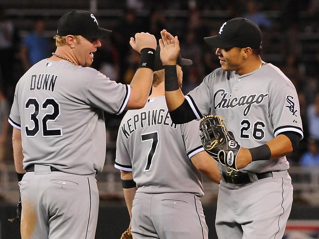 . White Sox first baseman Adam Dunn, left, and center fielder Avisail Garcia high-five after beating the Twins. (Pioneer Press: John Autey)