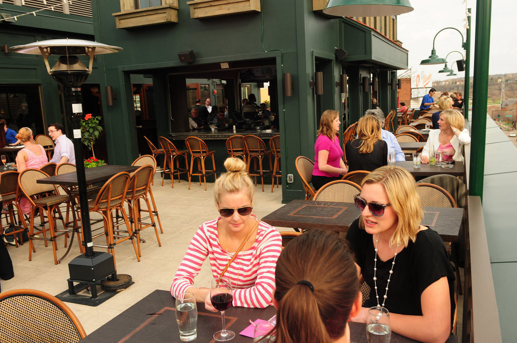 . Louis\' patio beckoned Brenna Curran of Woodbury, Bre Schumann of St. Paul and Emily Hafner of Minneapolis for drinks on May 6, 2013.The new restaurant on Cosetta\'s top floor opened its patio to patrons this spring. (Pioneer Press: Scott Takushi)
