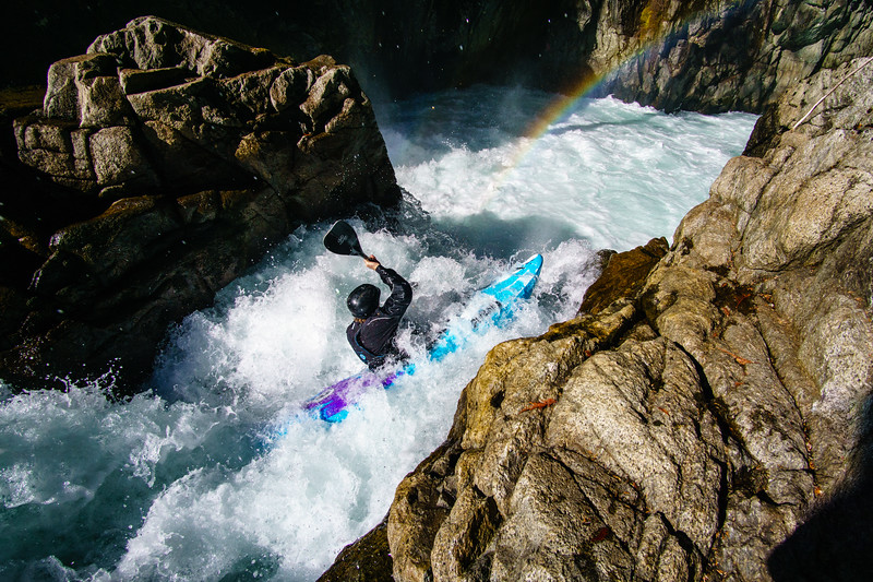 Dan Warner boofs into a rainbow on the Upper Cheakamus River near Whistler, British Columbia.
