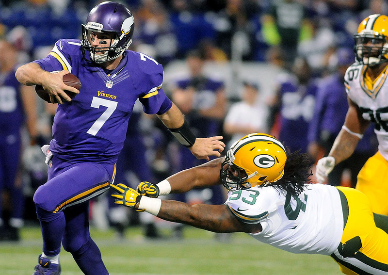 . Minnesota Vikings quarterback Christian Ponder scores a touchdown as he shakes off defender Josh Boyd during the fourth quarter. (Pioneer Press: Sherri LaRose-Chiglo)