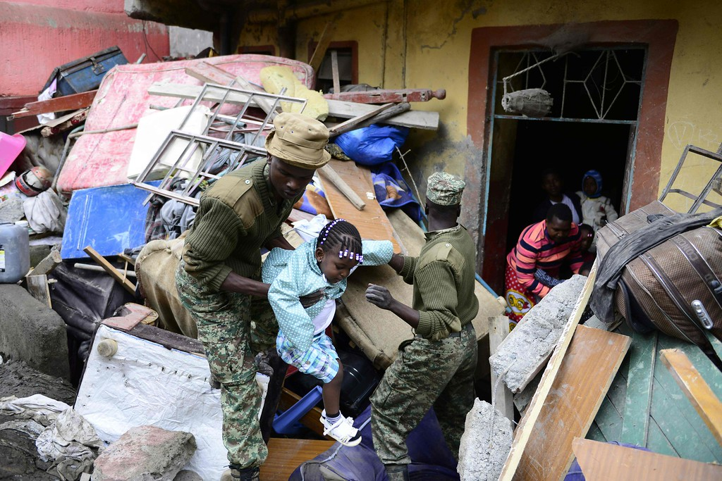 . Kenyan security forces carry a girl as people are evacuated from the vicinity of a collapsed building in Nairobi on April 30, 2016.  / AFP PHOTO / JOHN  MUCHUCHA/AFP/Getty Images