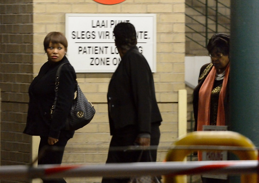 """. The former wife of Nelson Mandela, Winnie Mandela Madikizela, and their daughter Zindzi (L) leave the hospital where the former South African President is hospitalized on June 28, 2013 in Pretoria. The ex-wife of ailing Nelson Mandela on Friday said that the anti-apartheid icon\'s condition had improved in recent days, but he was still \""""unwell.\""""  ERIC FEFERBERG/AFP/Getty Images"""