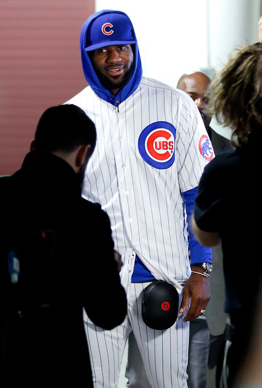 . Cleveland Cavaliers\' LeBron James arrives as he wears a Chicago Cubs uniform before an NBA basketball game against the Chicago Bulls, Friday, Dec. 2, 2016, in Chicago. (AP Photo/Nam Y. Huh)