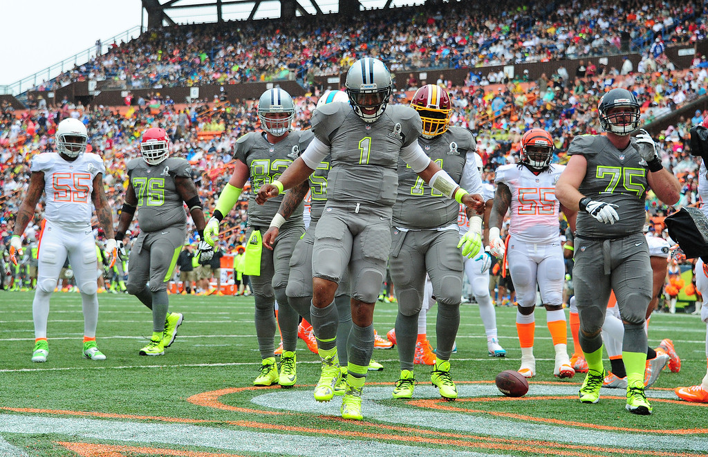 . Cam Newton #1 of the Carolina Panthers and Team Sanders celebrates after scoring a touchdown against Team Rice during the 2014 Pro Bowl at Aloha Stadium on January 26, 2014 in Honolulu, Hawaii  (Photo by Scott Cunningham/Getty Images)