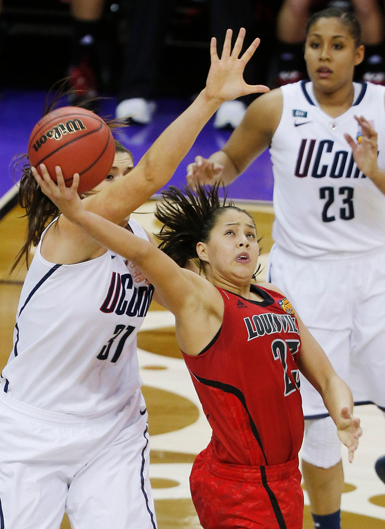 . Louisville guard Shoni Schimmel (23) goes up for a shot against Connecticut center Stefanie Dolson (31) during the second half of the national championship game of the women\'s Final Four of the NCAA college basketball tournament, Tuesday, April 9, 2013, in New Orleans. (AP Photo/Bill Haber)