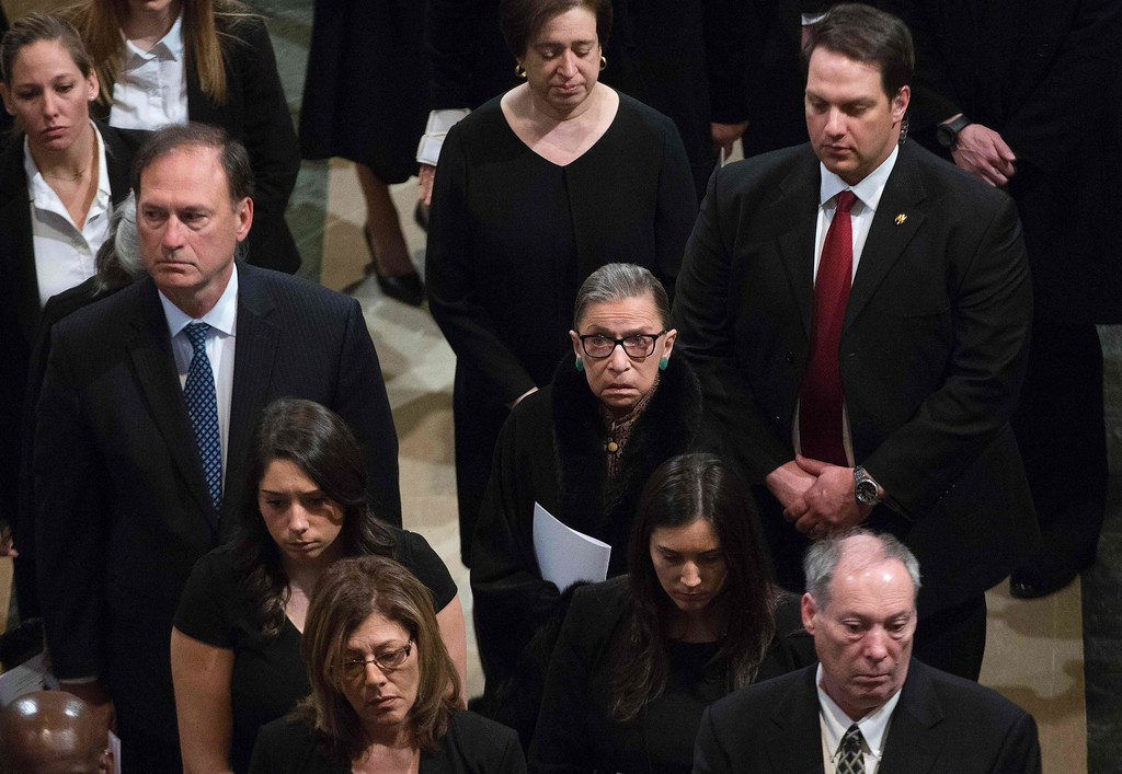 . Justices Ruth Bader Ginsburg (C), Samuel A. Alito (L) and Elena Kagan (C top) depart the funeral Mass for US Supreme Court Justice Antonin Scalia at the Basilica of the National Shrine of the Immaculate Conception in Washington, DC,  on February 20, 2016.  / AFP / POOL / Doug MILLS/AFP/Getty Images