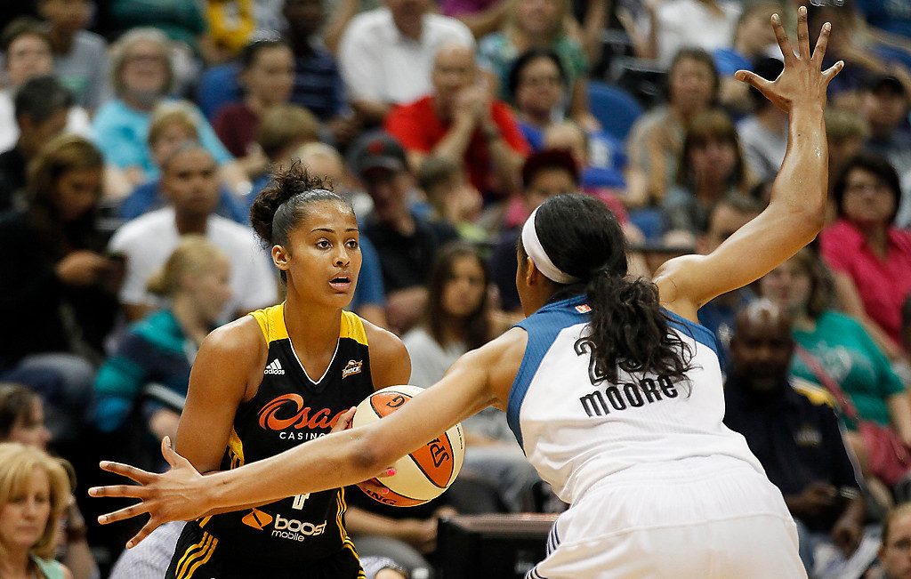 . Tulsa Shock guard Skylar Diggins, left, looks for an opening to pass the ball against Minnesota Lynx forward Maya Moore, right, in the first half. (AP Photo/Stacy Bengs)