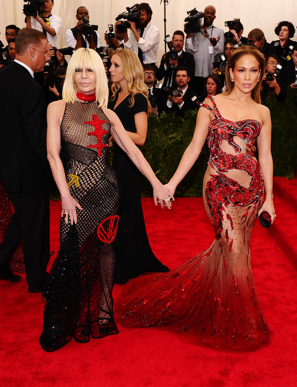 ". Jennifer Lopez, right, and Donatella Versace  arrive at The Metropolitan Museum of Art\'s Costume Institute benefit gala celebrating ""China: Through the Looking Glass\"" on Monday, May 4, 2015, in New York. (Photo by Charles Sykes/Invision/AP)"