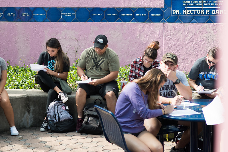 Students take notes as Professor Gabriel Ferreyra gives a lecture following a Drug Bust demonstration in Hector P. Garcia Plaza.