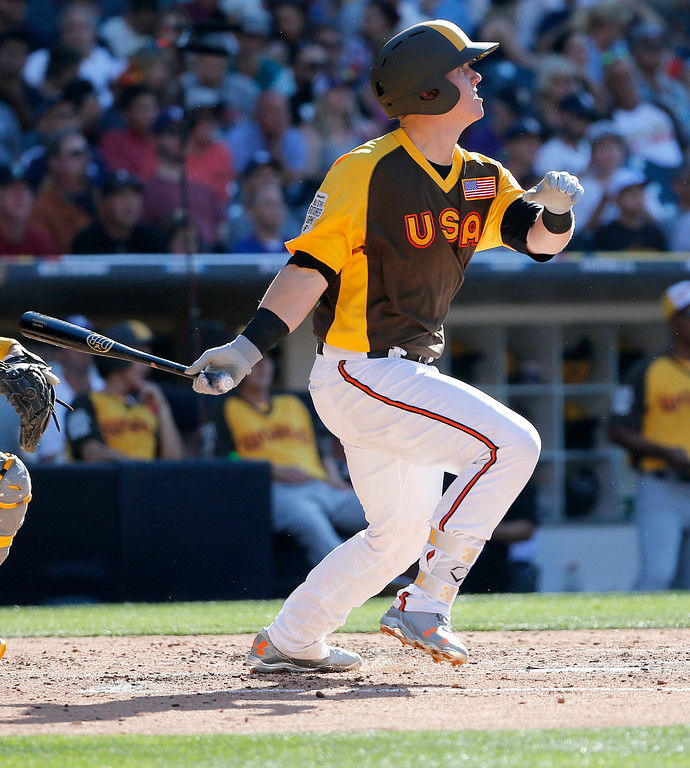 . U.S. Team\'s Chance Sisco, of the Baltimore Orioles, watches his solo home run take flight during the fourth inning of the All-Star Futures baseball game against the World Team, Sunday, July 10, 2016, in San Diego. (AP Photo/Lenny Ignelzi)