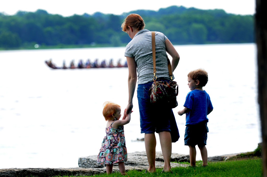 . Katie Wlashchin, her son Alex, 3 1/2 and daughter Josie, 1, watch the dragon boats warm up for the races. (Pioneer Press: Sherri LaRose-Chiglo)