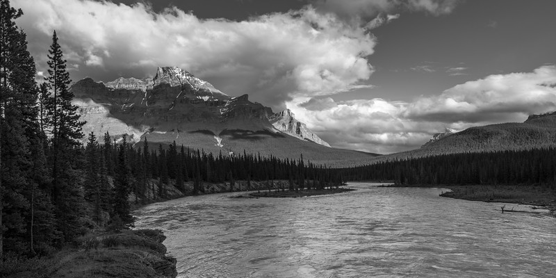 River flowing through landscape with mountains in the background, Icefields Parkway, Improvement District 9, Banff National Park, Jasper, Alberta, Canada
