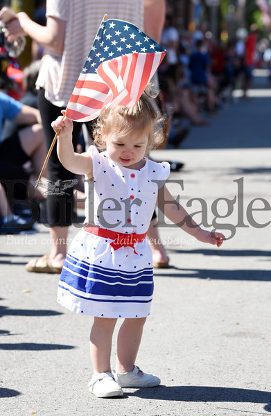 Harold Aughton/Butler Eagle: Carsyn Grossman, 1 1/2, of Butler waves her flag during the Butler Memorial Day Parade, Monday, May 27.