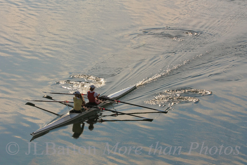 """Early Morning Practice 2010-08-23  Two rowers out for practice on the """"New Danube"""" channel in Vienna.  No power boats - and no sails in this section.  Thanks for the chuckles and comments about the prairie dog with 'bad hair'.  I enjoyed that shot too."""
