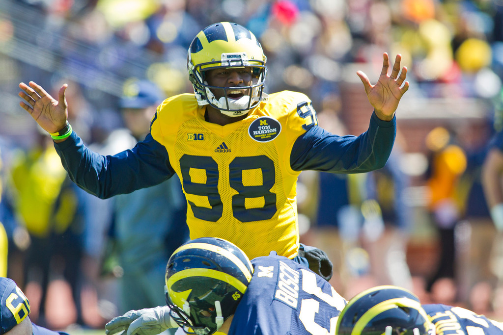 . Michigan quarterback Devin Gardner (98) shouts an audible to his offensive line before a snap, during the football team\'s annual spring game, Saturday, April 5, 2014, in Ann Arbor, Mich. (AP Photo/Tony Ding)