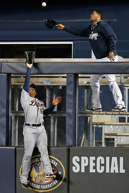 . Detroit Tigers center fielder Ezequiel Carrera (61) can\'t get to Brian McCann\'s seventh-inning home run in a baseball game against the New York Yankees at Yankee Stadium in New York, Wednesday, Aug. 6, 2014.  (AP Photo/Kathy Willens)