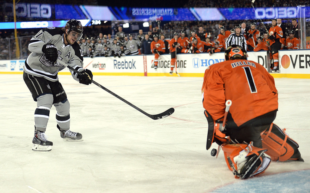 . Anaheim Ducks goalie Jonas Hiller (1) stops a shot on goal by Los Angeles Kings center Anze Kopitar (11) in the first period of the inaugural NHL Stadium Series game at Dodger Stadium in Los Angeles on Saturday, Jan. 25, 2014. (Keith Birmingham Pasadena Star-News)