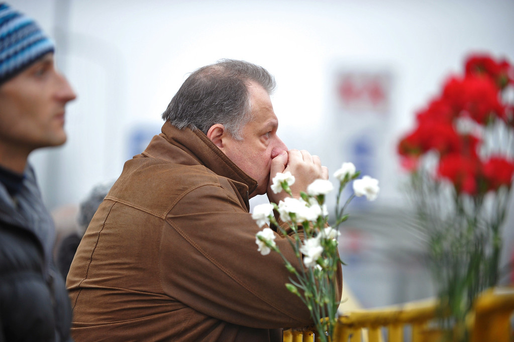 . A man waits for news at the scene where the Maxima supermarket roof collapsed in Riga on November 22, 2013. AFP PHOTO/ILMARS ZNOTINS/AFP/Getty Images