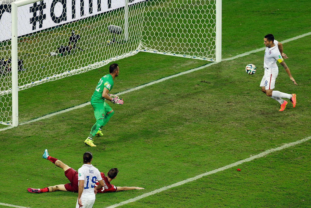 . United States\' Clint Dempsey, right, scores his side\'s second goal during the group G World Cup soccer match between the USA and Portugal at the Arena da Amazonia in Manaus, Brazil, Sunday, June 22, 2014. (AP Photo/Themba Hadebe)