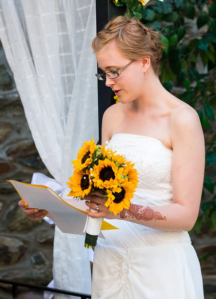 Bride at the altar reading vows 1.jpg