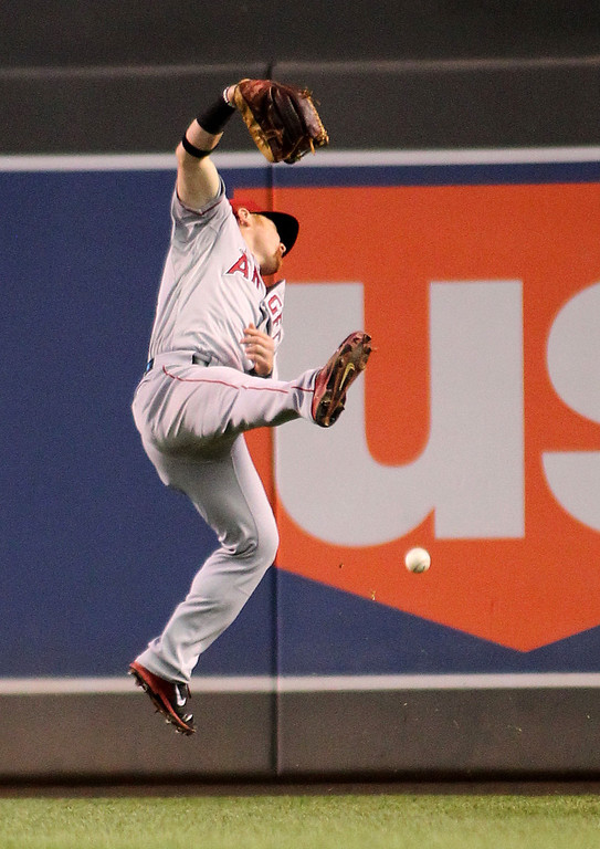 . Los Angeles Angels right fielder Kole Calhoun misses a fly ball by Minnesota Twins Ryan Doumit in the 8th inning of their baseball game won by the Twins 6-3 in Minneapolis Monday, Sept. 9, 2013.(AP Photo/Andy Clayton-King)