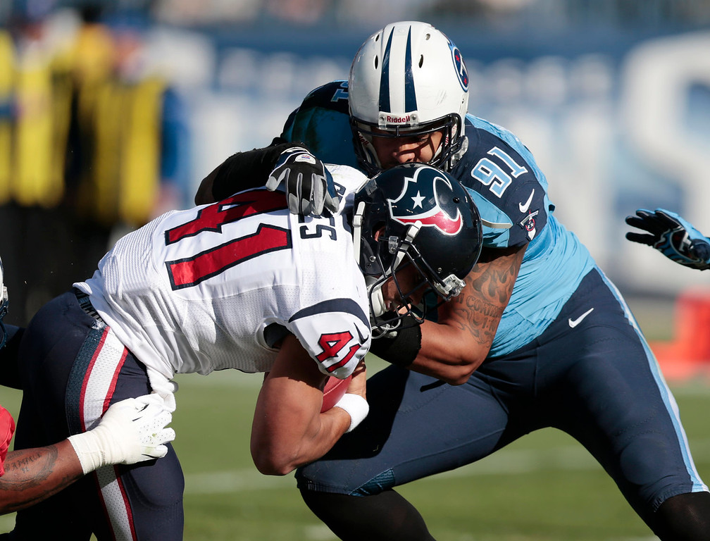 . Houston Texans running back Jonathan Grimes (41) gets past Tennessee Titans defensive end Derrick Morgan (91) as Grimes scores a touchdown on a 3-yard run in the first quarter of an NFL football game Sunday, Dec. 29, 2013, in Nashville, Tenn. (AP Photo/Wade Payne)