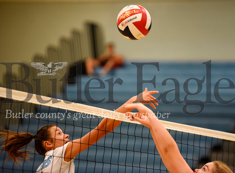 Harold Aughton/Butler Eagle: Seneca Valley junior, Sarah White, #13, tips the ball over for a point in the first game of last night's match against North Hills.
