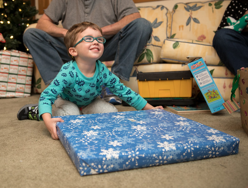 Caleb Opening Present looking up with smile.jpg