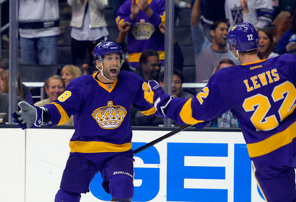 . Los Angeles Kings center Jarret Stoll, left, celebrates a goal by center Trevor Lewis, right, during the second period of their NHL hockey game against the Colorado Avalanche, Saturday, Feb. 23, 2013, in Los Angeles. (AP Photo/Mark J. Terrill)