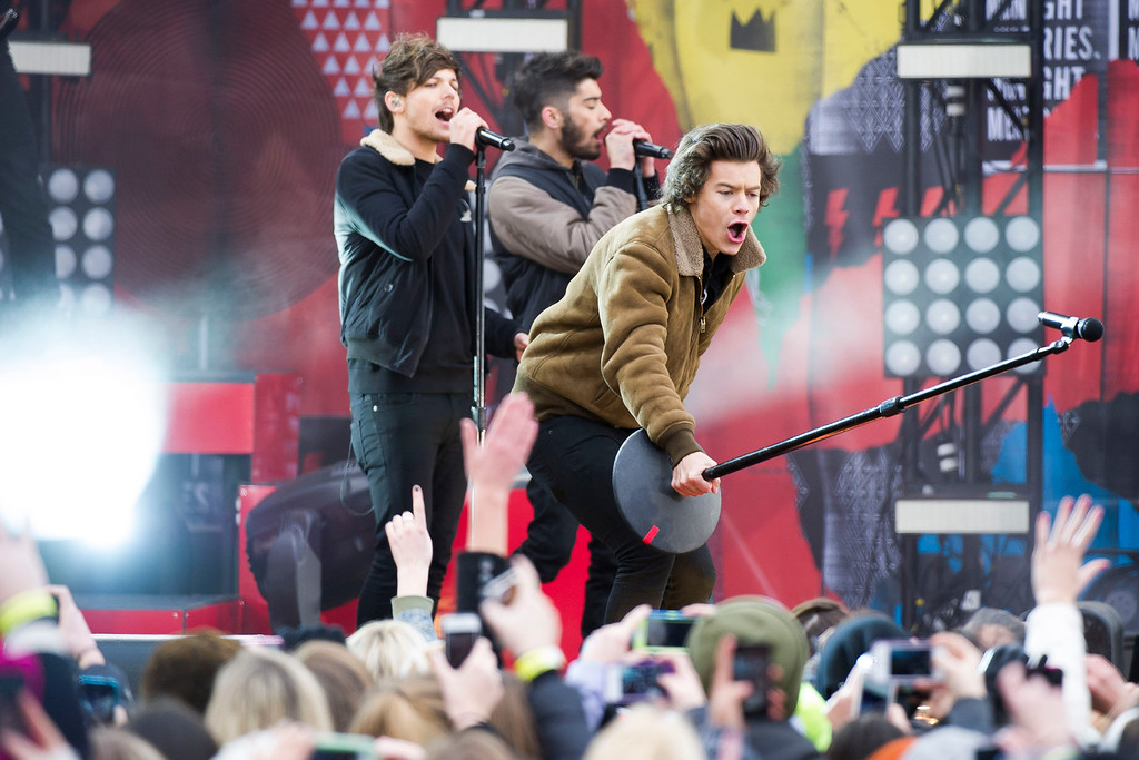 """. One Direction members, from left, Louis Tomlinson, Zayn Malik and Harry Styles perform on ABC\'s \""""Good Morning America\"""" on Tuesday, Nov. 26, 2013 in New York. (Photo by Charles Sykes/Invision/AP)"""