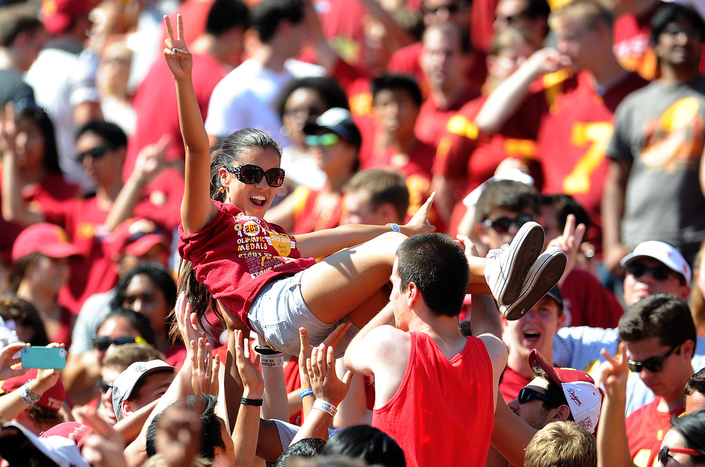 . Southern California fans react after a touchdown against Boston College during the second half of an NCAA college football game in the Los Angeles Memorial Coliseum in Los Angeles, on Saturday, Sept. 14, 2013. Southern California won 35-7. 