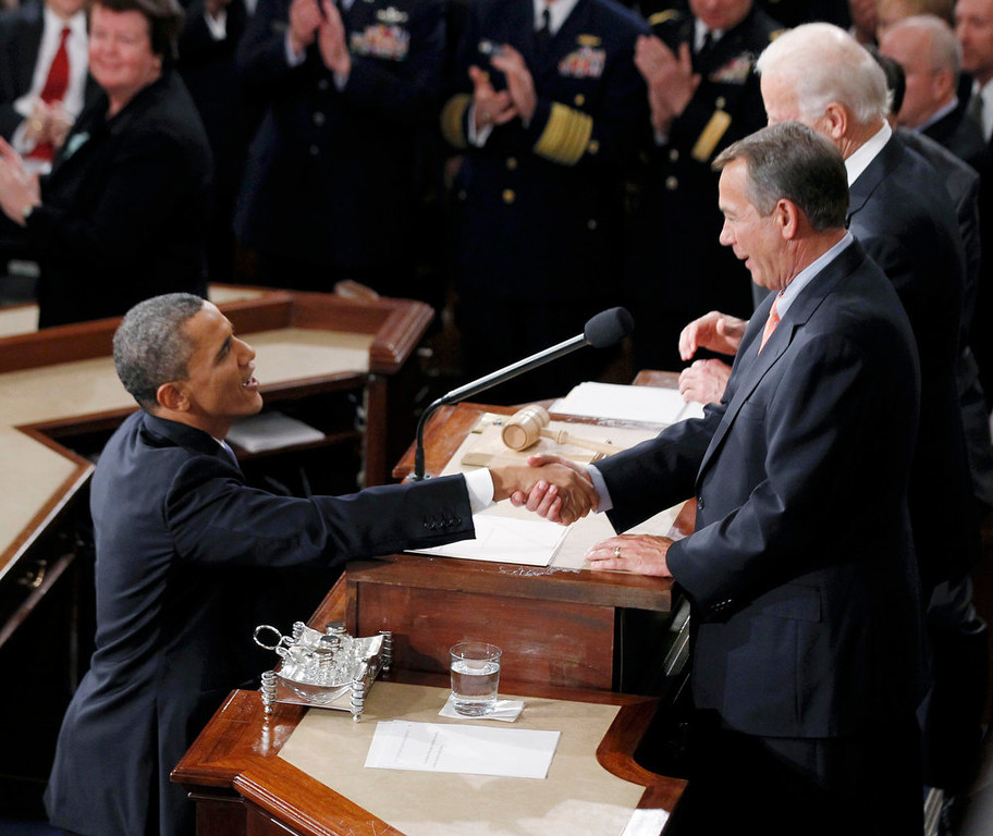 . U.S. President Barack Obama shakes hands with House Speaker John Boehner (R) as he arrives to deliver his State of the Union Speech on Capitol Hill in Washington, February 12, 2013. REUTERS/Jason Reed